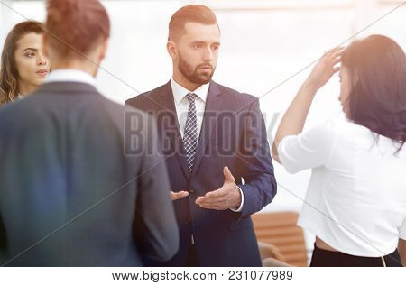 business people argue standing in office