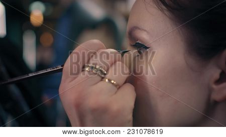 Closeup Make-up Artist Is Putting On Make-up On Model's Eyes In Beauty Salon. Professional Eye Make-