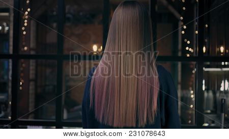 Lovely Young Woman Turns To The Camera, Smiles And Plays With Her Long Colorful Hair In Beauty Salon