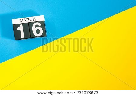 March 16th. Day 16 Of March Month, Calendar On Blue And Yellow Background Flat Lay, Top View. Spring