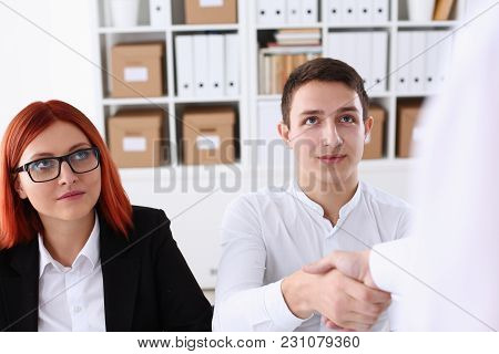 Smiling Man In Shirt Shake Hands As Hello In Office Portrait. Friend Welcome Mediation Offer Positiv