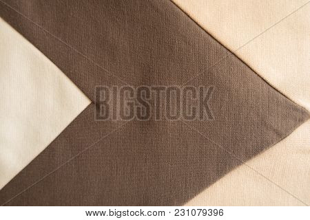Angled Brown Stripe Sewn To Beige Fabric