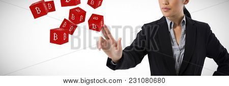Businesswoman pressing an invisible virtual screen against big red cube with bit coin logo on each side