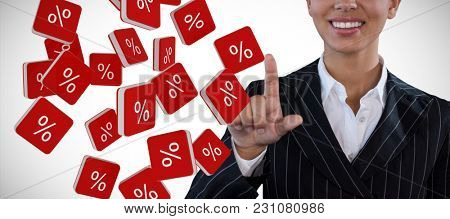 Portrait of smiling businesswoman in suit touching invisible interface against percent sign vector icon