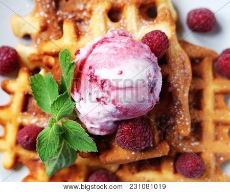 Waffles with raspberry ice cream and fresh raspberries, decorate