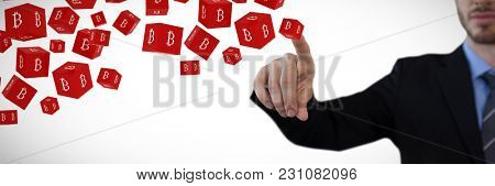 Cropped image of businessman touching index finger on invisible screen against cube with bit coin sign on each side digital currency