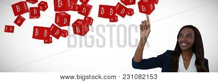 Businesswoman touching interface screen against several red cube with bit coin sign on each side