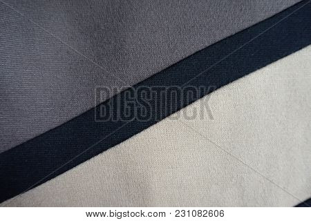 Black Stripe Sewn To Grey And Beige Fabric Diagonally