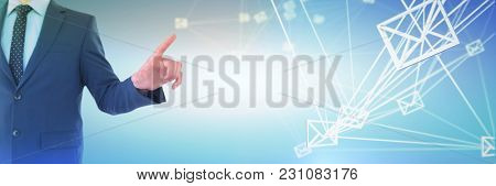 Mid section of businessman selecting on imaginary screen against abstract blue background