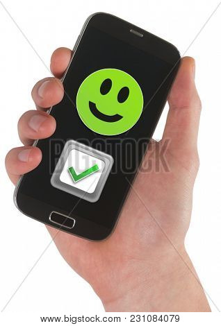 Digital composite of Hand holding phone with smiley face and correct tick feedback