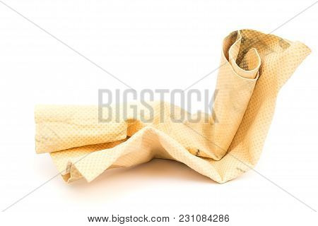 Dry Dirty Yellow Chamois (microfiber Towel) For Cleaning On White Background