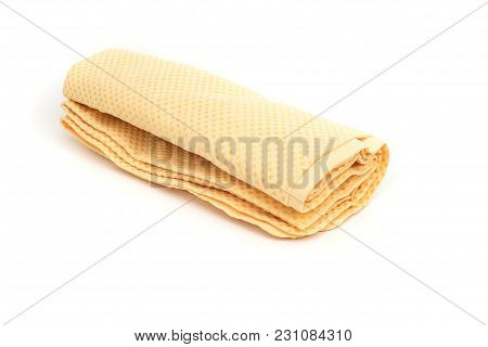 Rolled Of Yellow Chamois (microfiber Towel) For Cleaning Concept On White Background