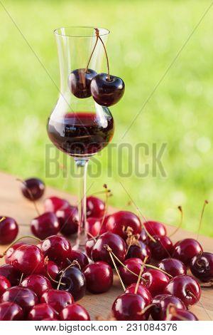 Cherry Liquor And Juicy Ripe Berries .