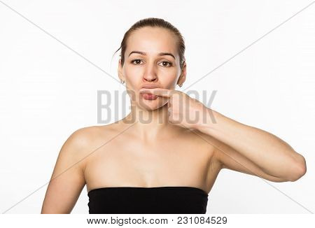 Prevention Of Skin Aging, Woman Performs Exercises For A Face Building.
