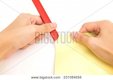Hand Put Red Plastic Slide Binder For Document On Yellow Paper Isolated On White Background