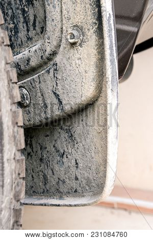 Close-up Of Cement Powder On Mudguard And Wheel