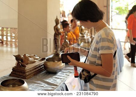 Women Make Annual Merit In Local Temple. Women Largesse With Coin.