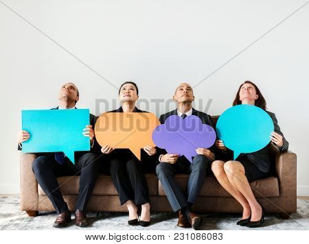 Business people sitting together with icons