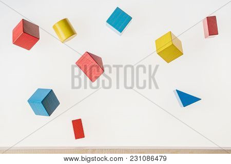 Colorful Wooden Geometric Shapes Are Floating. Concept Of Creative, Logical Thinking. Abstract Geome