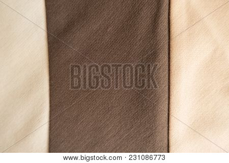 Brown Stripe Sewn To Beige Fabric Vertically