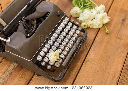 Retro Typewriter And White Ranunculus