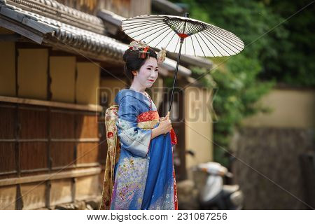 Kyoto, Japan - June 10: Unidentified Woman Dress Like A Maiko, Japanese Women Usually Makeup As Geis