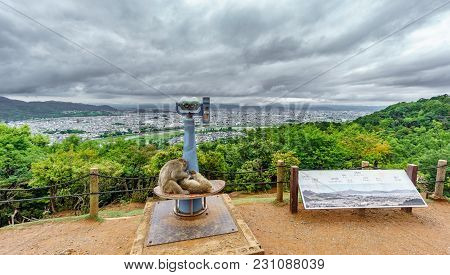Top View Of Kyoto From Arashiyama Mountain Viewpoint With Monkey And Binocular, Cloudy Day