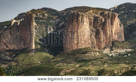 Entire Riglos Mallets And Town With -el Puro-
