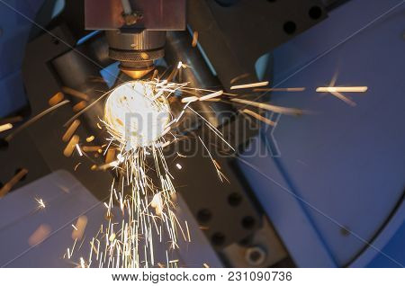The Fiber Laser Cutting Machine Cutting The Stainless Pipe With The Sparking Light.