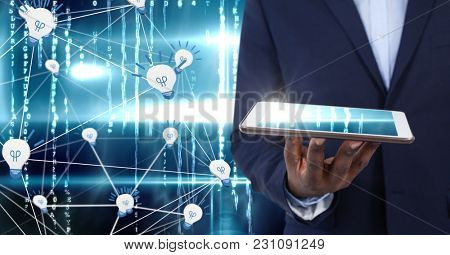 Digital composite of Hand holding tablet with light bulb icons in technology background