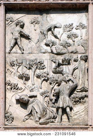 VERONA, ITALY - MAY 27: Martyrdom of saint Peter of Verona, relief on Facade of Saint Anastasia Church in Verona, Italy, on May 27, 2017.