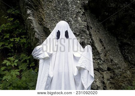 Ghost Standing In Front Of A Rock