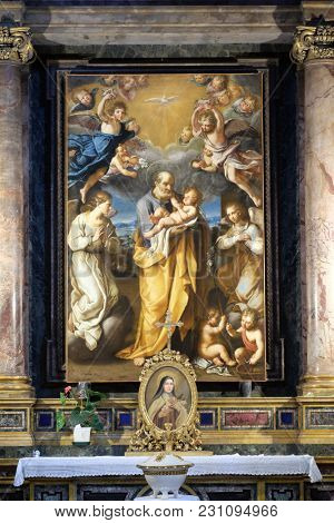 ROME, ITALY - SEPTEMBER 03: St Joseph with baby Jesus altarpiece by Francesco Cozza in Chapel Chapel of St Joseph, Basilica di Sant Andrea delle Fratte, Rome, Italy on September 03, 2016.