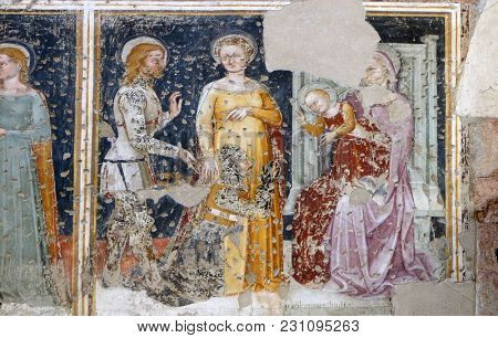 VERONA, ITALY - MAY 27: Enthroned Madonna and Child, Saint George, a Saint and a worshipper Knight, fresco in the church of San Pietro Martire in Verona, Italy, on May 27, 2017.
