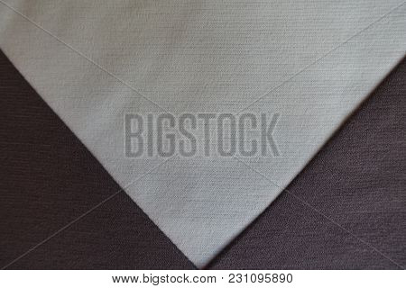 Cream Triangular Gusset Sewn To Brown Fabric