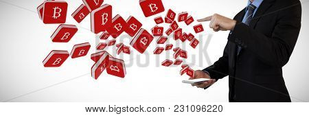 Mid section of businessman in suit gesturing over smart phone against bit coin symbol