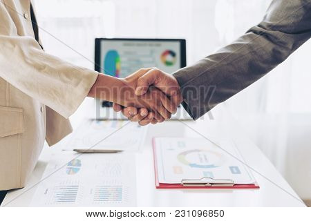 Close Up Hand Of Business  People Shaking Hands Finishing Up Meeting Showing Unity , Business Teamwo