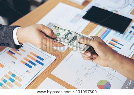 Close Up Hand Of Business Giving Or Paying Money  Us Dollar Bill