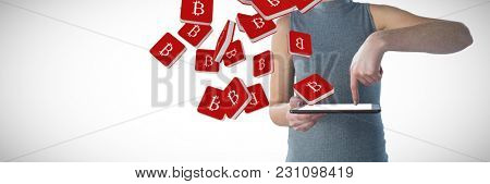 Mid section of businesswoman using digital tablet against bit coin symbol