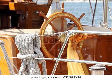 The Helm At Old Sailing Boat Moored In Mediterranean Sea, Croatia