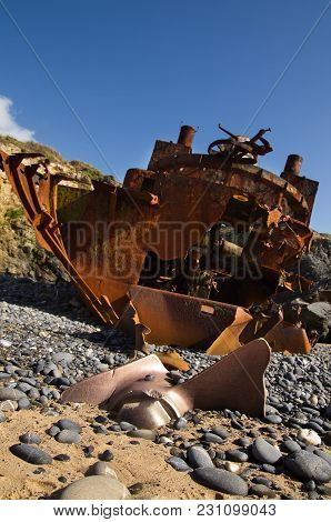 Withered And Half Buried Propeller Of A Wrecked Pusher Boat