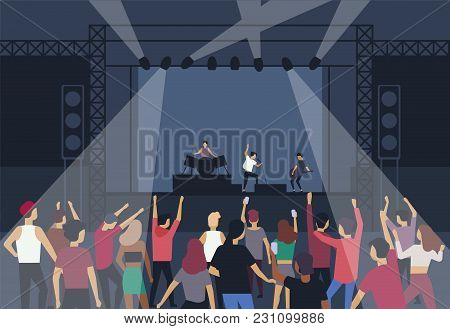 Large Group Of People Or Music Fans Dancing In Front Of Stage With Performing Musical Band, Back Vie