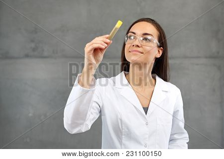Laboratory Woman Holding A Test Tube With A Urine Sample