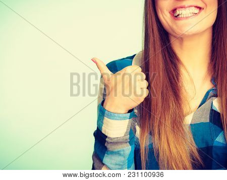 Happiness And Fun Concept. Happy Smiling Woman In Checked Shirt Showing Ok, Good, Thumb Up Gesture.