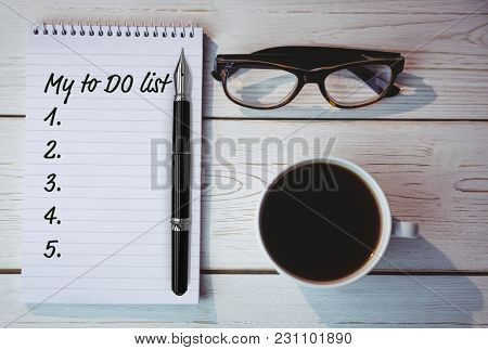 to do list from 1 to 5 against overhead shot of notepad