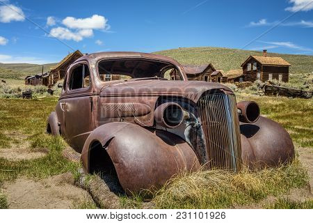 Car Wreck In Bodie Ghost Town, California. Bodie Is A Historic State Park From A Gold Rush Era  In T