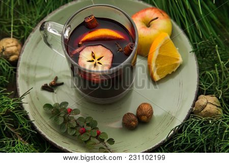 Glintwine In A Cup, Homemade Hot Alcoholic Drink For Holidays With Branches Of Fir As Winter Decorat