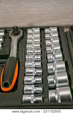 A Set Of New Heads With Ratchet Wrenches For Car Repairs.