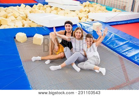 A Portrait Of Happy Family In Trampoline Center