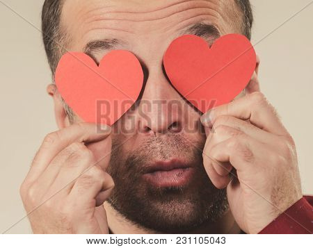 Adult Serious Man Covering Eyes With Red Hearts. Male Blinded By Love. Romance Feelings Valentines D